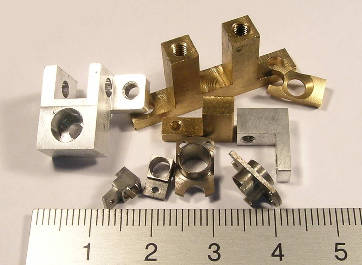 Milled parts,  titanium and brass